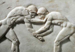Greek civilization, Plinth of kouros statue, bas-relief depicting wrestlers, circa 510 B.C., detail, from Kerameikos necropolis in Athens, Greece