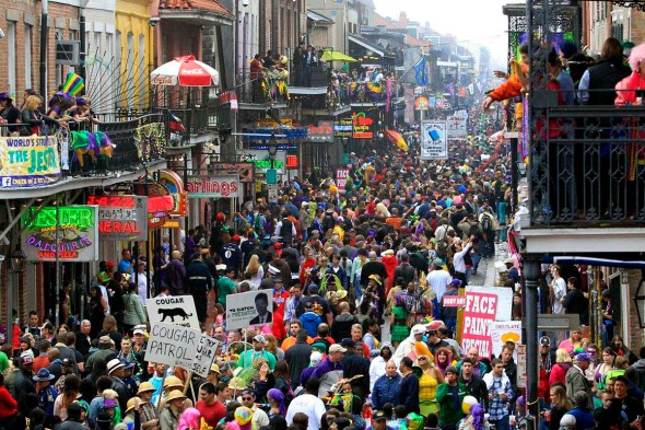 Crowds flood Bourbon Street on Mardi Gras Day in New Orleans