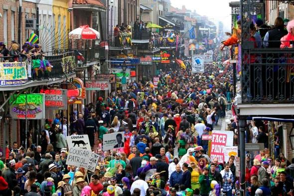 Crowds flood Bourbon Street on Mardi Gras Day in New Orleans